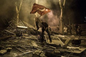 occupy_gezi_protest_scene_pile_of_fences_turkey_flag_2013